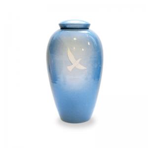 Keramische urn in aqua blauwe kleur met witte vogel